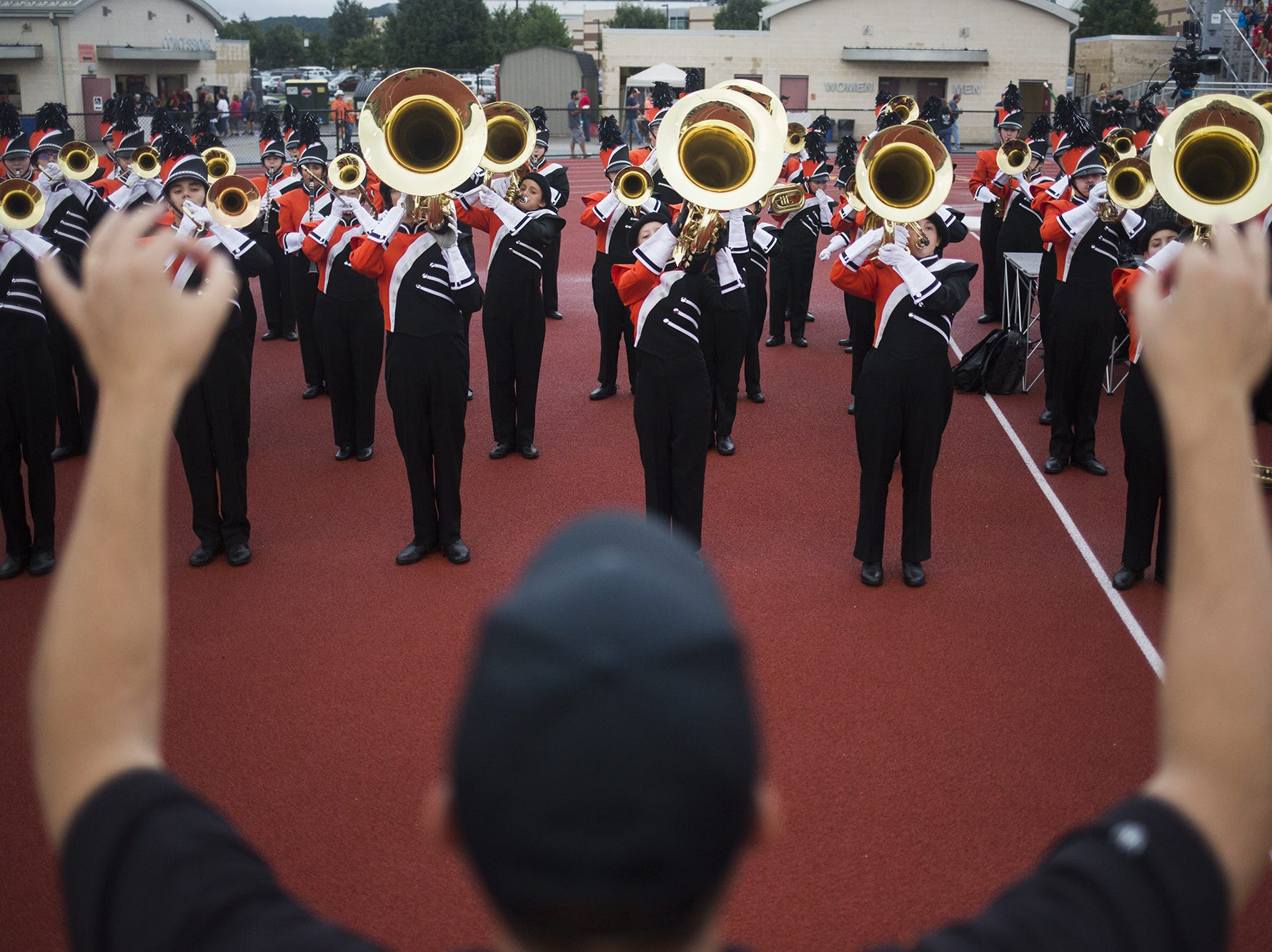 The Central York High School marching band prepares before their performance before the game. Central York defeats Cumberland Valley 31-14 in football at Central York High School in Springettsbury Township, Friday, August 31, 2018.