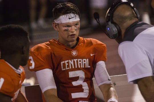 Central York quarterback Cade Pribula speaks with a coach on the sideline. Central York defeats Cumberland Valley 31-14 in football at Central York High School in Springettsbury Township, Friday, August 31, 2018.