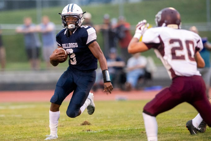West York's Ay'jaun Marshall (3) looks for running room while returning a kick, Friday, Aug. 31, 2018. The Shippensburg Greyhounds beat the West York Bulldgos, 21-14.