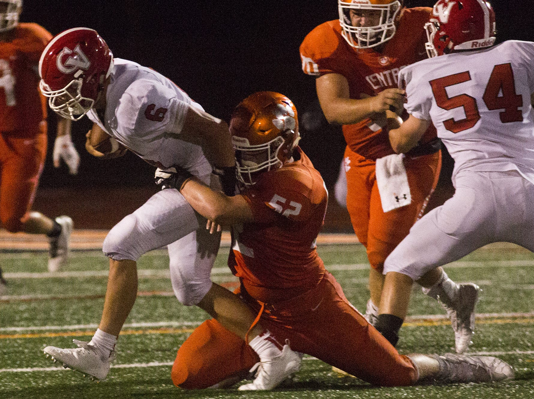 Cumberland Valley quarterback Jared Plessinger is sacked by Central York's Ian McNaughton. Central York defeats Cumberland Valley 31-14 in football at Central York High School in Springettsbury Township, Friday, August 31, 2018.