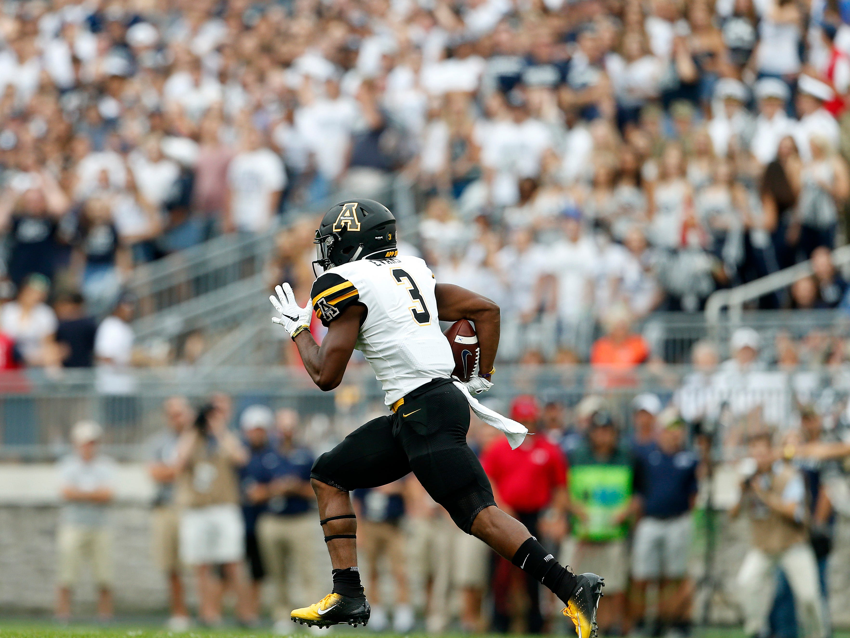 Appalachian State's Clifton Duck (4) runs back a kick for a 100 yards against Penn State during the first half of an NCAA college football game in State College, Pa., Saturday, Sept. 1, 2018. (AP Photo/Chris Knight)