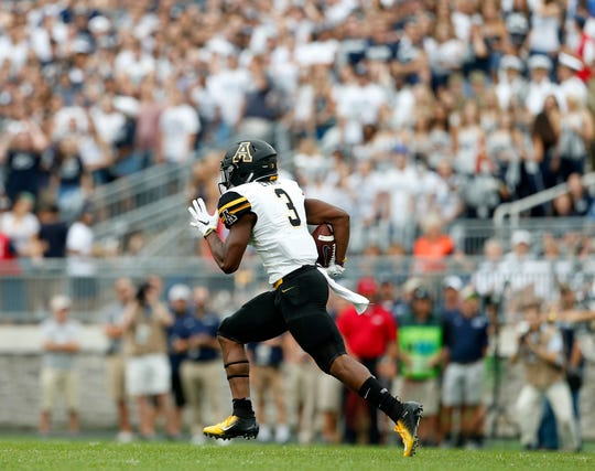 Appalachian State's Darrynton Evans (3) runs back a kick for a 100 yards against Penn State during the first half of an NCAA college football game in State College, Pa., Saturday, Sept. 1, 2018. (AP Photo/Chris Knight)