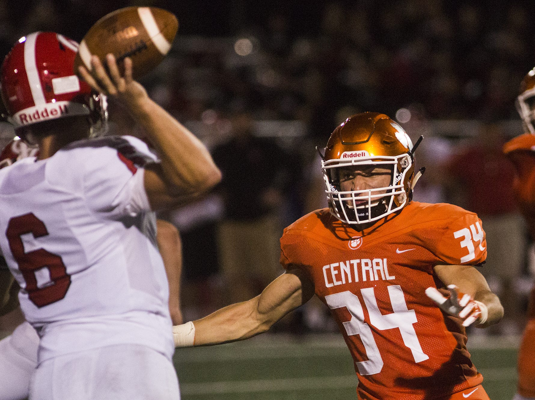 Central York's Anthony Tsirigos, right, pressures Cumberland Valley quarterback Jared Plessinger. Central York defeats Cumberland Valley 31-14 in football at Central York High School in Springettsbury Township, Friday, August 31, 2018.