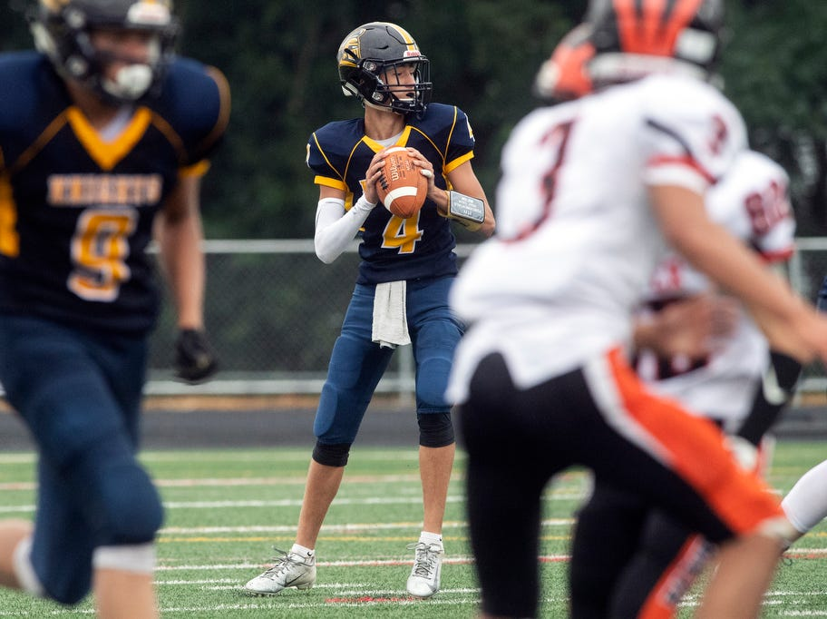 Eastern York quarterback Trevor Seitz (4) drops back to look for a pass, Saturday, September 1, 2018. The Eastern York Golden Knights (2-0) beat the Hanover Nighthawks (0-2) 47-21, at Eastern York High School.