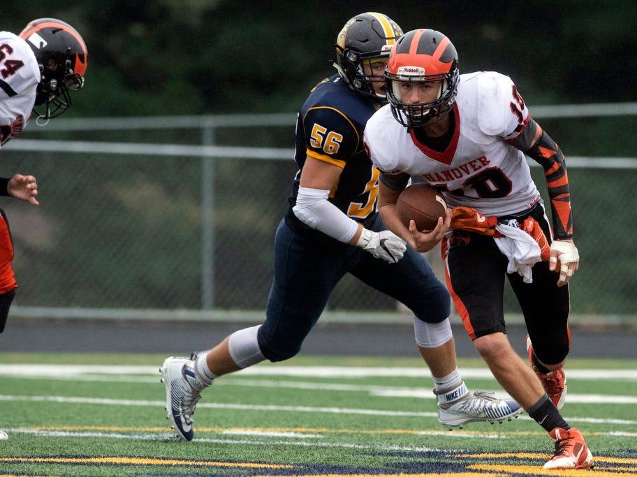 Hanover quarterback Sam Duvall (18) looks for running room against Eastern York, Saturday, September 1, 2018. The Eastern York Golden Knights (2-0) beat the Hanover Nighthawks (0-2) 47-21, at Eastern York High School.