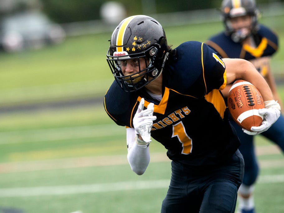 Eastern York's Bryce Henise (1) looks for more running room en route to a touchdown, Saturday, September 1, 2018. The Eastern York Golden Knights (2-0) beat the Hanover Nighthawks (0-2) 47-21, at Eastern York High School.
