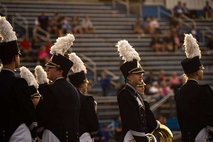 Members of the Spring Grove marching band await their performance before a football game between Muhlenberg and Spring Grove, Friday, Aug. 31, 2018, in Spring Grove.