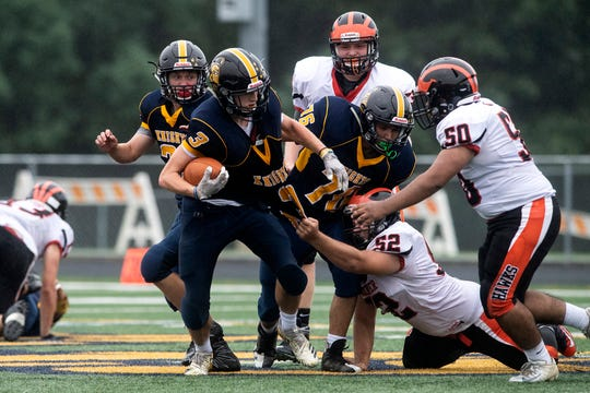 Hanover's Shane Warehime (52) works to pull down Eastern York's Dylan Zurin (3), Saturday, September 1, 2018. The Eastern York Golden Knights (2-0) beat the Hanover Nighthawks (0-2) 47-21, at Eastern York High School.