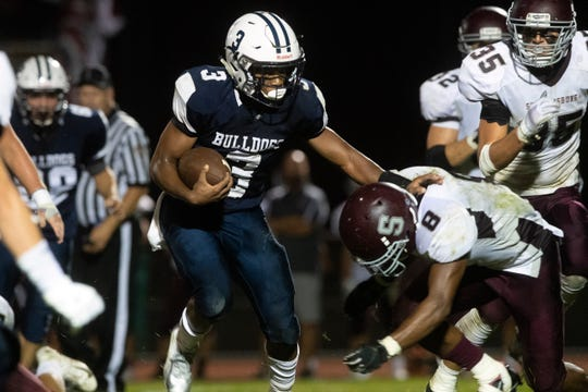 West York's Ay'jaun Marshall (3) stiff arms Shippensburg's Adam Houser (8), Friday, Aug. 31, 2018. The Shippensburg Greyhounds beat the West York Bulldgos, 21-14.