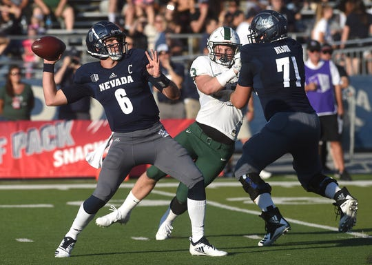 Nevada's Ty Gangi throws a pass while taking on Portland State during their football game at Mackay Stadium in Reno on Friday.