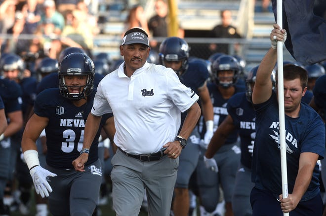 Nevada head coach Jay Norvell leads his team onto the field to take on Portland State at Mackay Stadium in Reno on Friday.