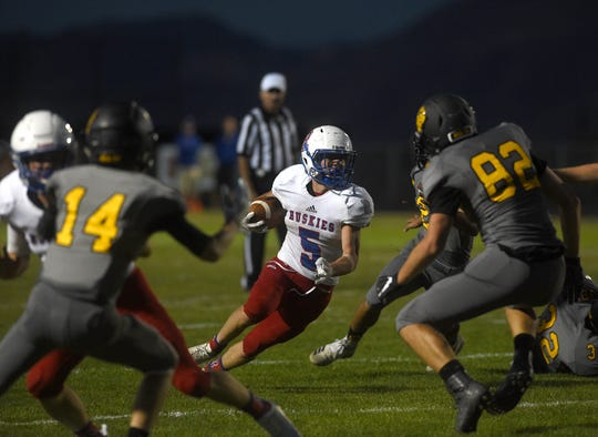 Reno's Drue Worthen (5) looks for room to run while taking on Galena during their football game at Galena on Aug. 30, 2018.