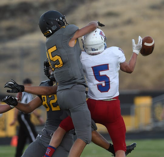 Reno's Drue Worthen (5) tries to make a catch while being guarded by Galena's Chase Nelson (15) during their football game at Galena on Aug. 30, 2018.