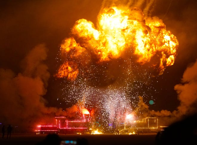 "A massive fireball roils into the night sky after an art installation of two (wooden) locomotives ""crashed"" into each other at Burning Man."