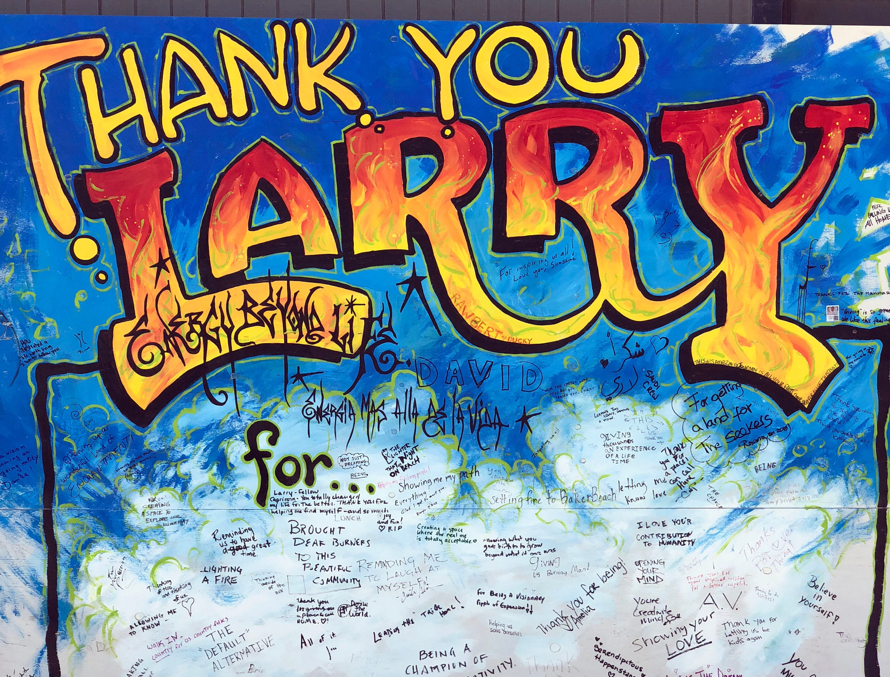 A mural on the wall at Burning Man's Center Camp holds memories written by attendees remembering founder Larry Harvey.Sept. 1, 2018; Reno, NV, USA; xxx Mandatory credit: Trevor Hughes-USA TODAY NETWORK