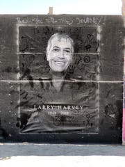 A poster on the wall at Burning Man's Center Camp depicts founder Larry Harvey, who died this spring following a stroke.