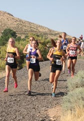 The girls  cross country race Friday at the Reed Invitational.