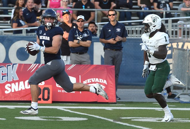 Nevada's McLane Mannix (1) looks back at Portland State's Romeo Gunt on his way to the end zone during Friday's game at Mackay Stadium.