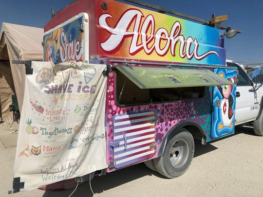 Victor Palmeri, Chris Rickett and Ruth Stoddard brought the shave ice machine and ice truck into the playa from Oahu, Hawaii.