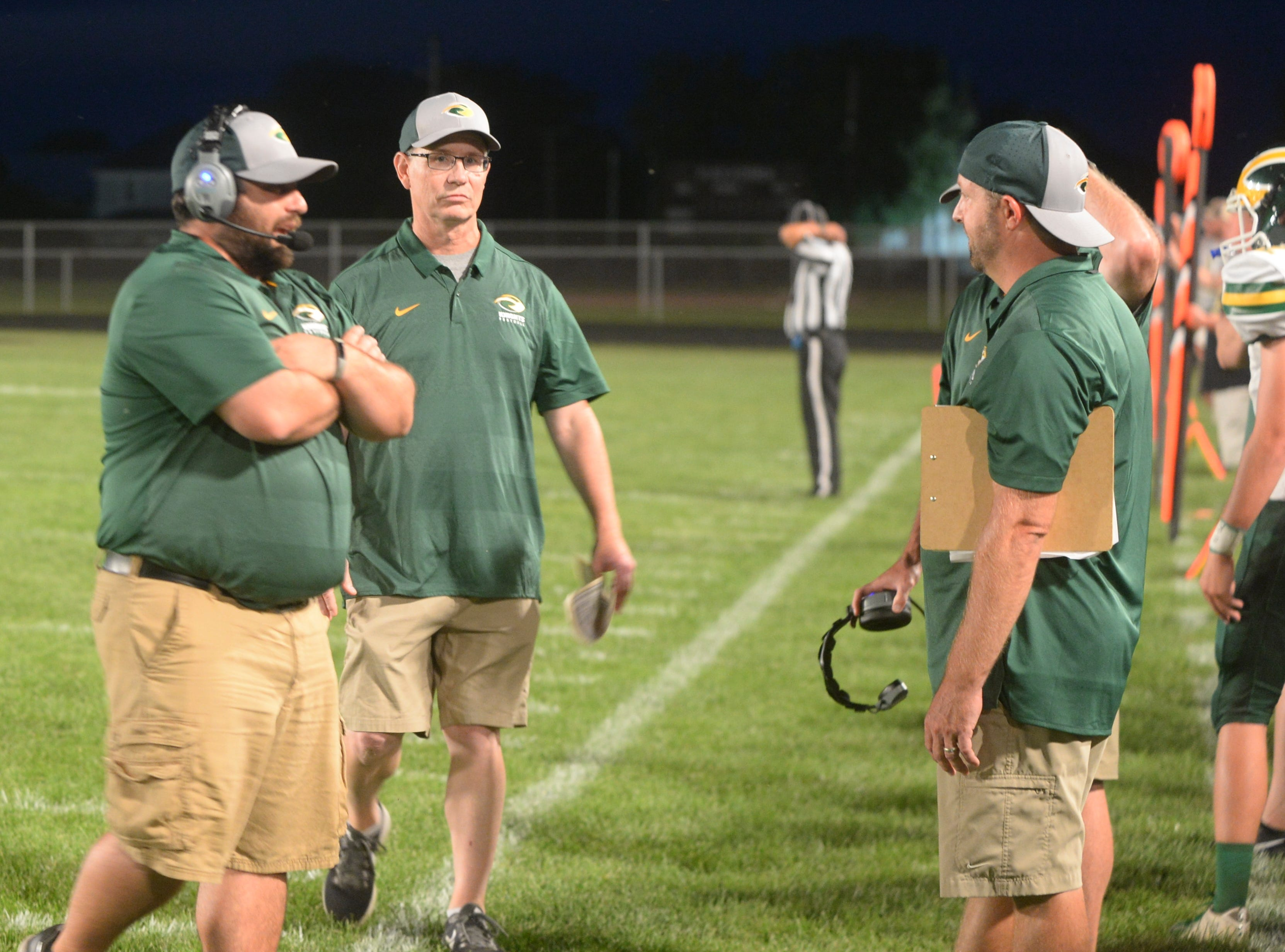 Northeastern head coach Mike Roeder (center) with his staff during a football game between Winchester and Northeastern Friday, Aug. 31, 2018. Northeastern won 24-20.