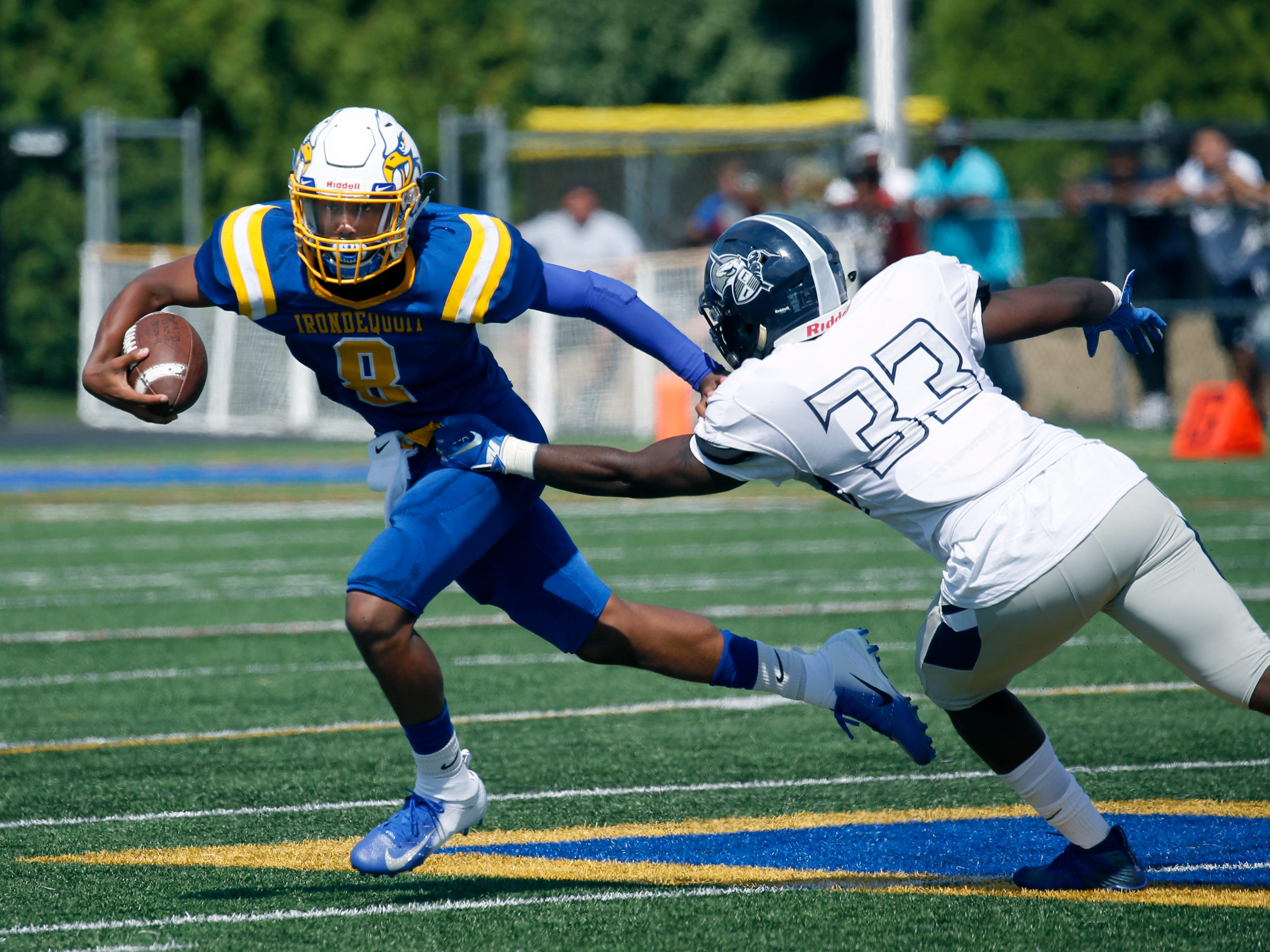 Irondequoit's Freddy June Jr. runs away from Eastridge's Aries Holt in the second quarter at Irondequoit High School.