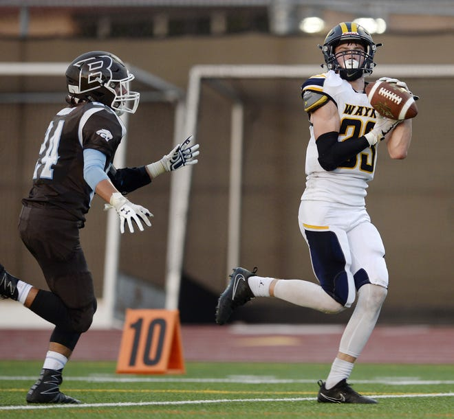 Wayne's Logan Blankenberg, right, catches a touchdown pass in a season-opening win over East Rochester/Gananda.