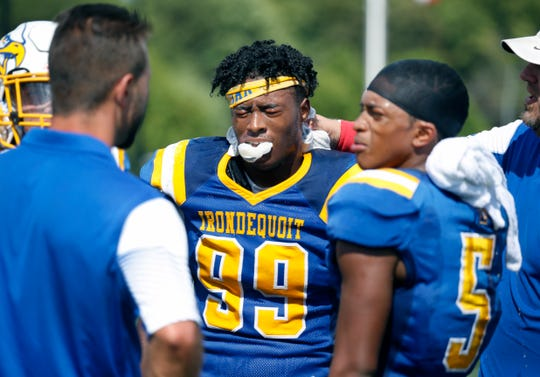 Irondequoit's Cameron Martin gets a towel with ice on his neck during a hot game against Eastridge in the second quarter at Irondequoit High School. Various players cramped during the game.