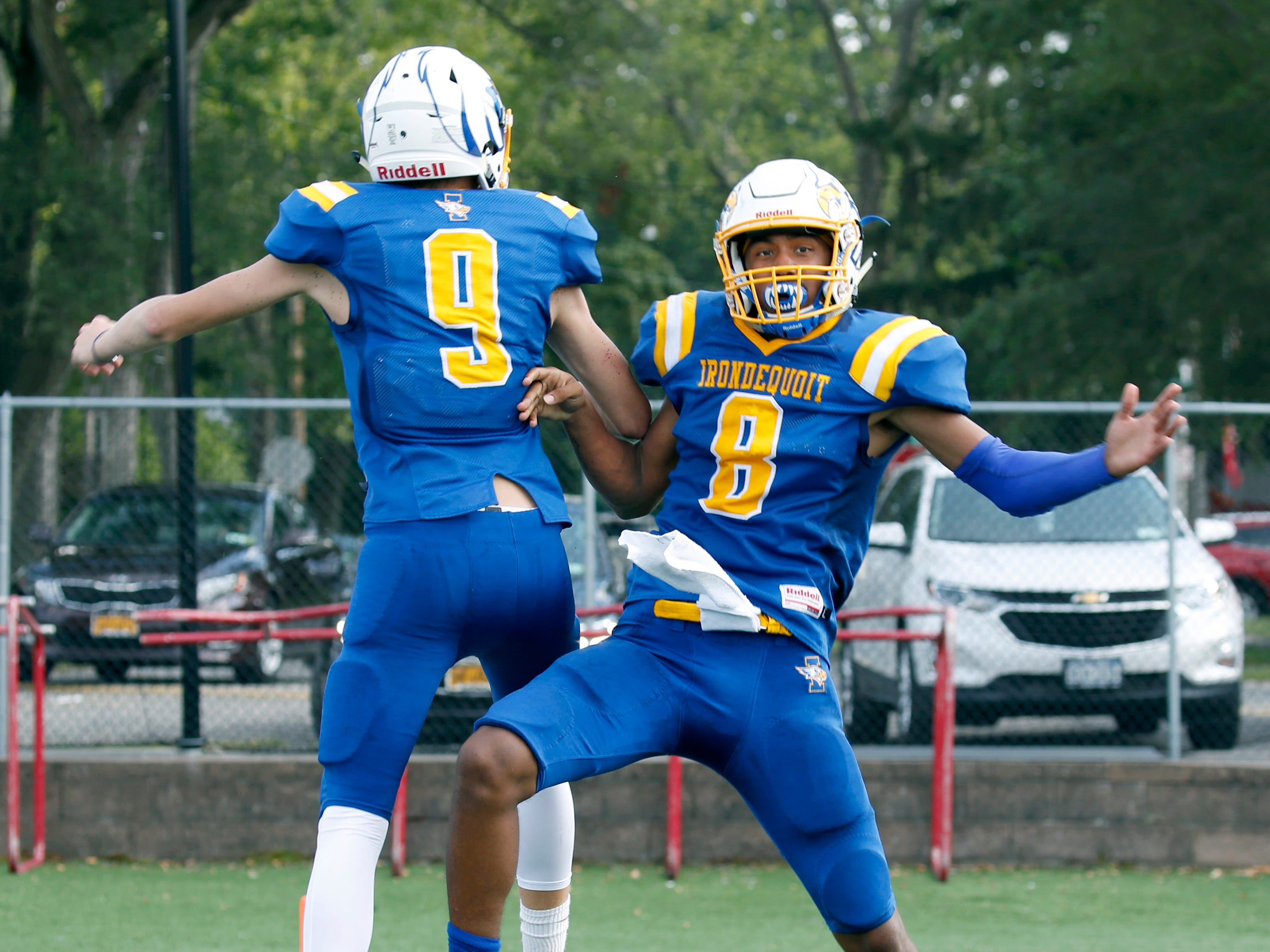 Irondequoit's Freddy June Jr. celebrates his touchdown with Quinn Simonson against Eastridge in the fourth quarter, to set what would be the final score of 21-10 after the kick at Irondequoit High School.