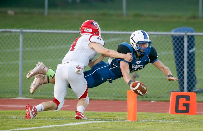 Batavia's Cody Burns dives for a  touchdown as Hornell's Demetrice Cabic tackles him in the first quarter at VanDetta Stadium in Batavia on Aug. 31.