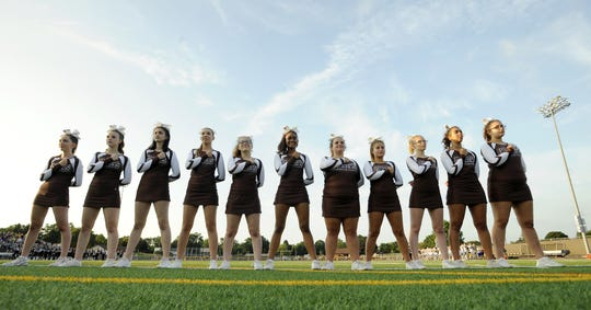East Rochester/Gananda cheerleaders stand for the national anthem during a regular season game against Wayne played at East Rochester High School, Friday, Aug. 31, 2018.\