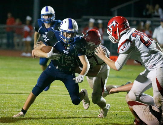 Batavia's Cody Burns is tackled near the end zone by Hornell's Ethan Nichols in the fourth quarter at Vandetta Stadium in Batavia.