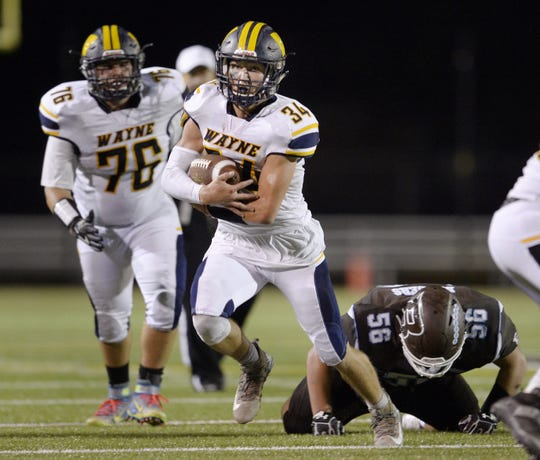 Wayne's Billy Thomson carries the ball during a regular season game against East Rochester/Gananda.