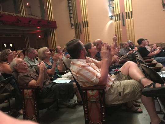 The audience clapped as part of a song at the Carr Fire Benefit Show at the Cascade Theatre on Aug. 31, 2018.