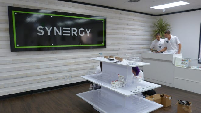 Staff ready Redding's first cannabis retail store, Synergy, for opening day in 2018.