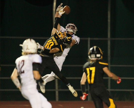West Valley's Devin Low (2) goes up for a catch in the end zone against Enterprise's Sean McDonald (10) in the fourth quarter of Friday night's game. Enterprise won 35-14.