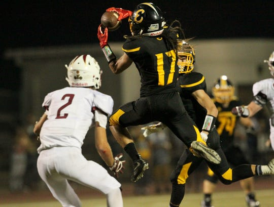 Enterprise's Matthew Amasaki (17) makes a catch next to West Valley's Devin Low (2) in the second quarter.