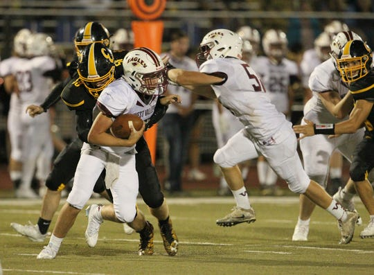 West Valley QB Kitt McCloughan (3) tries to break away from Enterprise DE Dyllan Johnson (58) in the backfield during the fourth quarter.