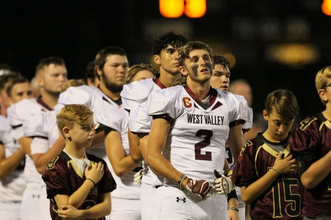 West Valley's Devin Low and fellow players stand for the national anthem before a game against Enterprise on Aug. 31.