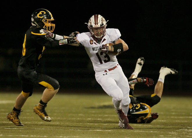 West Valley's Bailey Sulzer (13) tries to break away from Enterprise's Leslie Cummings in the first quarter on Friday, Aug. 31.