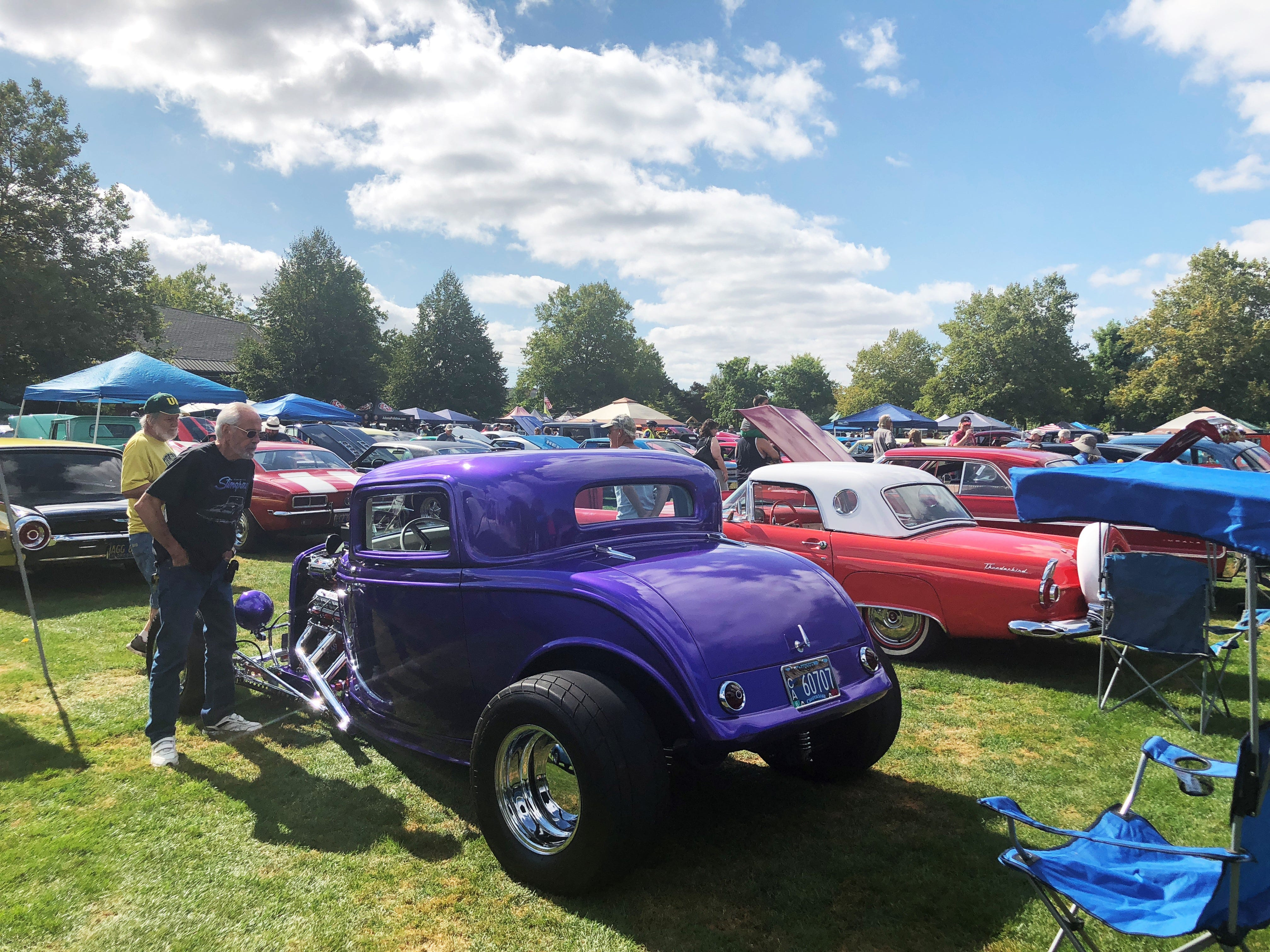 Spectators looking at a car at the 27th Annual Carousel Cruise at Riverfront Park in Salem on Saturday, Sept. 1.