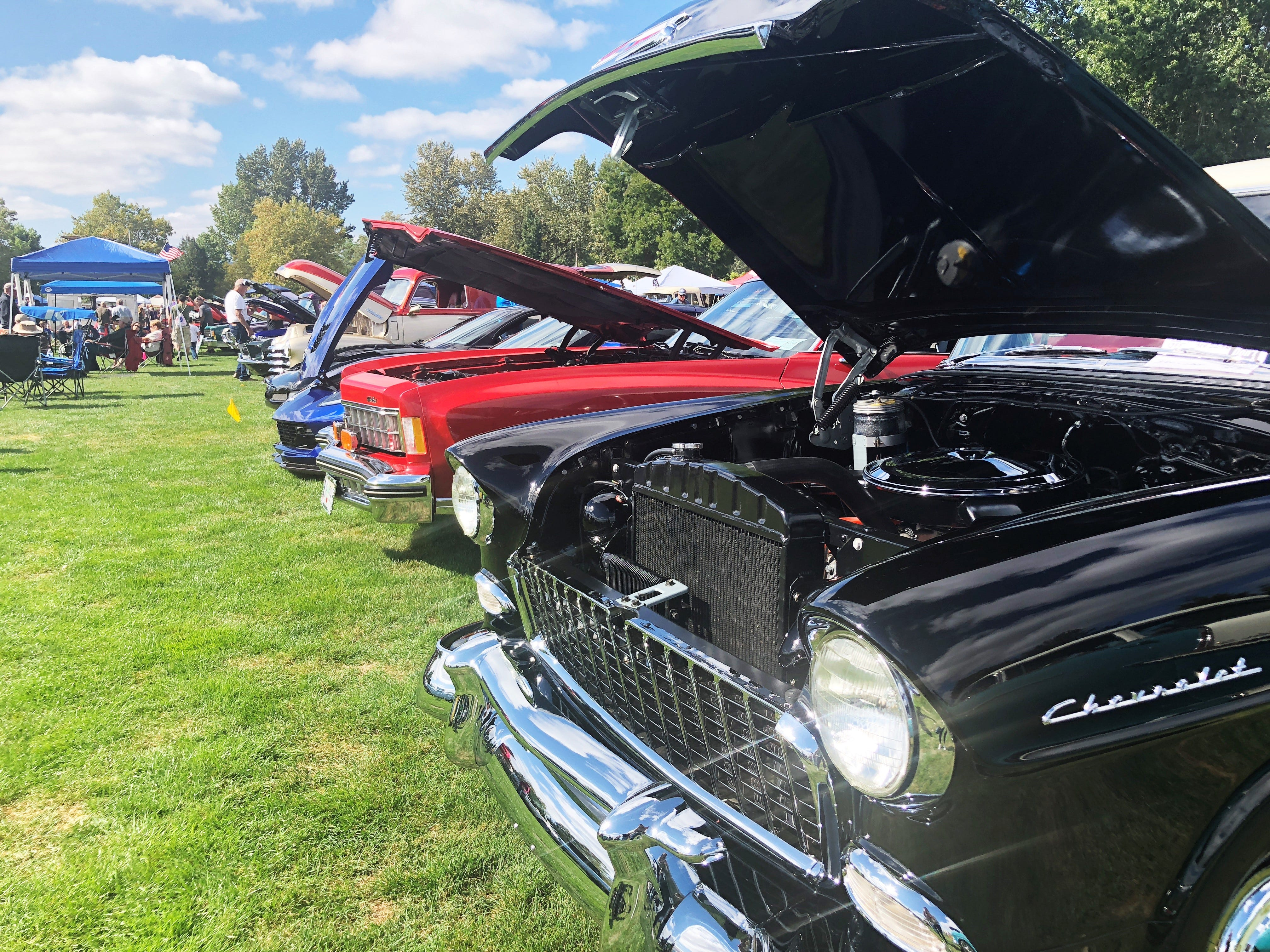 Cars with lifted hoods at the 27th Annual Carousel Cruise at Riverfront Park in Salem on Saturday, Sept. 1.