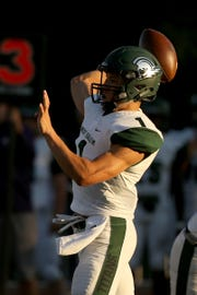 West Salem's Simon Thompson (1) looks to pass the ball in the first half of the West Salem vs. Lake Oswego football game at Lake Oswego High School on Friday, Aug. 31, 2018.
