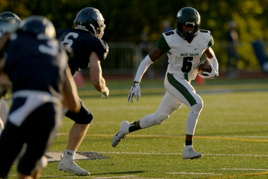West Salem's Jamal McMurrin (6) rushes in the first half of the West Salem vs. Lake Oswego football game at Lake Oswego High School on Friday, Aug. 31, 2018.