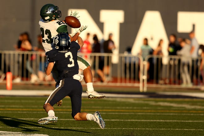 West Salem's Anthony Gould (23) jumps up for a catch past Lake Oswego's Joe Hutson (3) in the first half of the West Salem vs. Lake Oswego football game at Lake Oswego High School on Friday, Aug. 31, 2018.