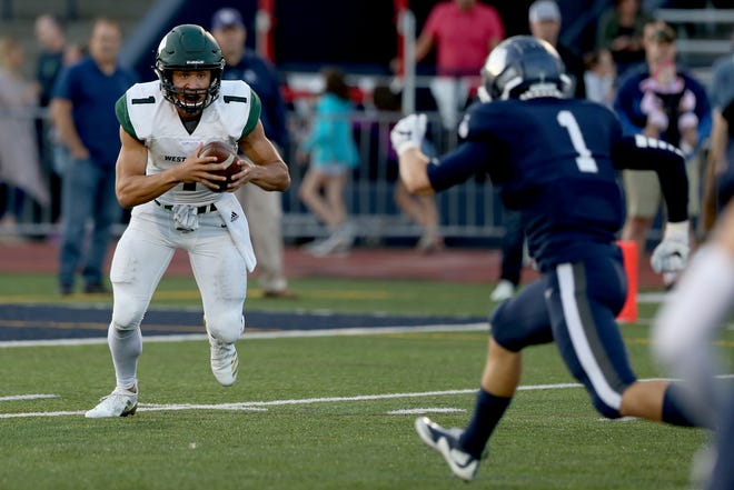 West Salem's Simon Thompson (1) faces Lake Oswego's Keenan DeRaeve (1) in the first half of the West Salem vs. Lake Oswego football game at Lake Oswego High School on Friday, Aug. 31, 2018.