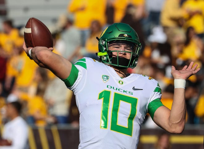 Sep 16, 2017; Laramie, WY, USA; Oregon Ducks quarterback Justin Herbert (10) warms up before a game against the Wyoming Cowboys at War Memorial Stadium. Mandatory Credit: Troy Babbitt-USA TODAY Sports