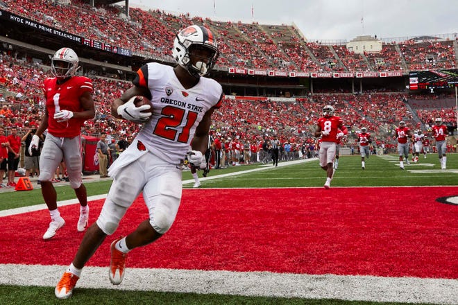 Sep 1, 2018; Columbus, OH, USA; Oregon State running back Artavis Pierce scored on touchdown runs of 80 and 78 yards in the third quarter, outrunning the Ohio State defense. Mandatory Credit: Rick Osentoski-USA TODAY Sports