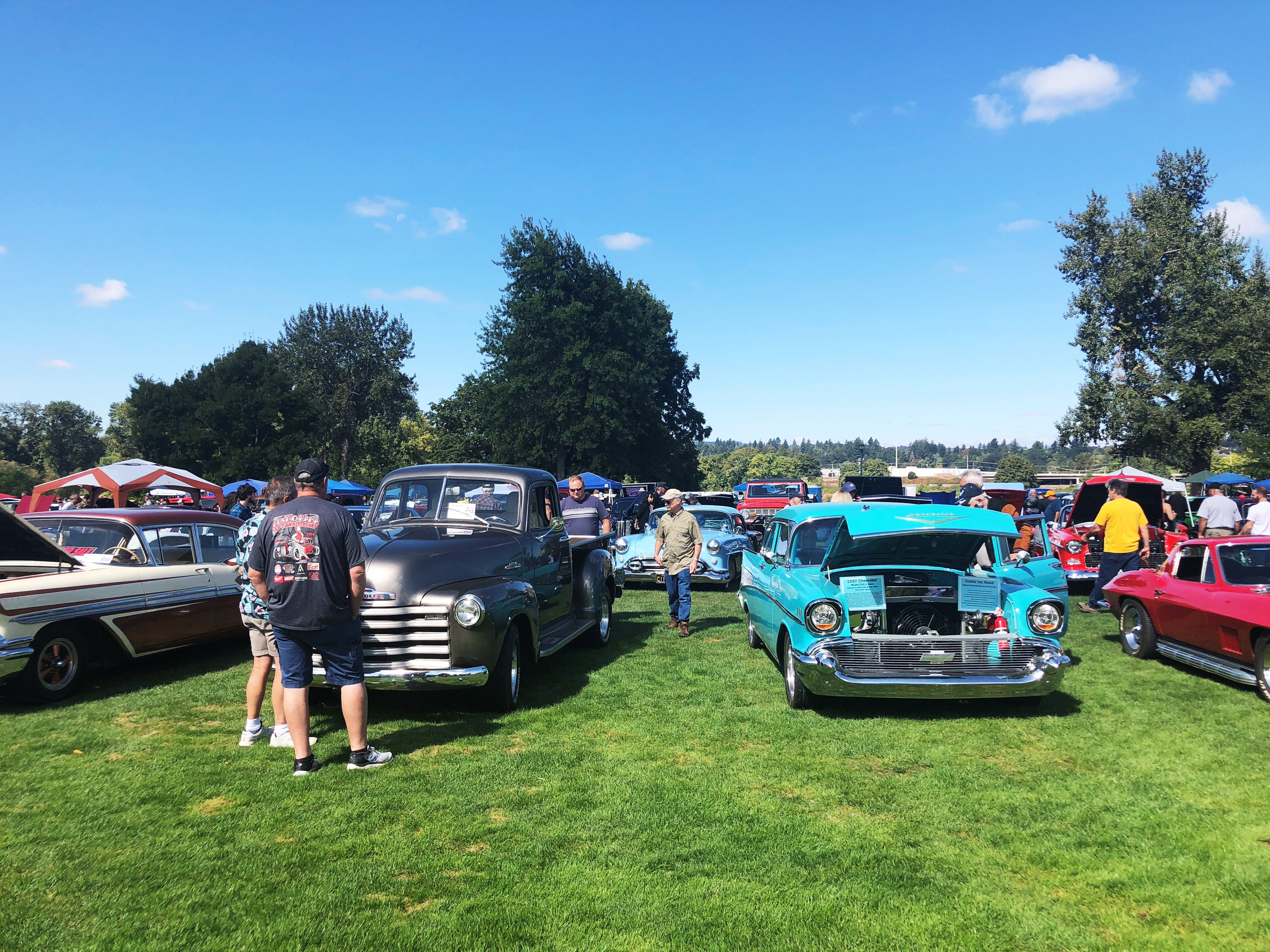 Spectators walk around the 27th Annual Carousel Cruise at Riverfront Park in Salem on Saturday, Sept. 1. The event featured more than 300 cars.