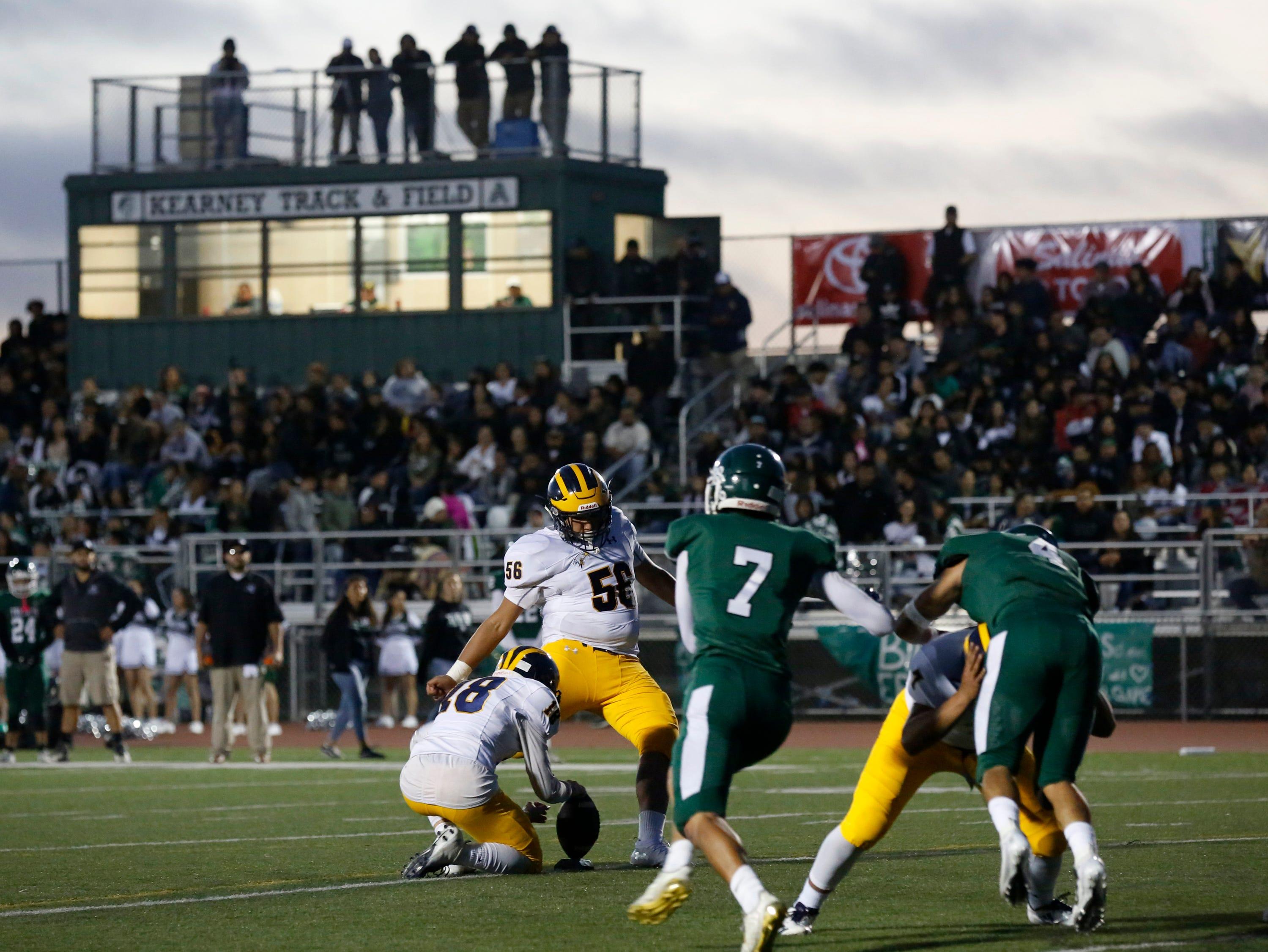 Everett Alvarez's Salvador Pandoja kicks an extra point during football at Alisal High School in Salinas on Friday August 31, 2018. (Photo By David Royal)