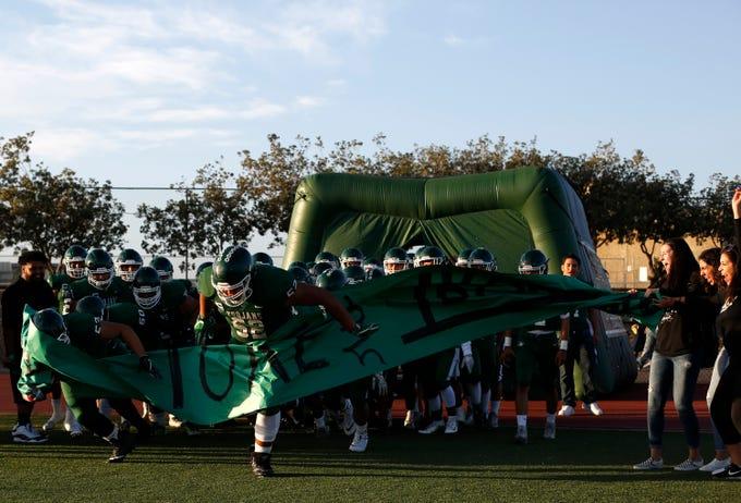 Alisal players enter the field before football against Everett Alvarezat Alisal High School in Salinas on Friday August 31, 2018. (Photo By David Royal)